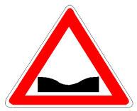Sinjali në figurë paralajmëron një pjesë rruge në formë të lugët (zbritje dhe ngjitje).