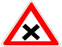 Sinjali në figurë na urdhëron të lëvizim me shpejtësi të kufizuar dhe t'u japim të drejtë kalimi mjeteve që vijnë nga krahu i djathtë.